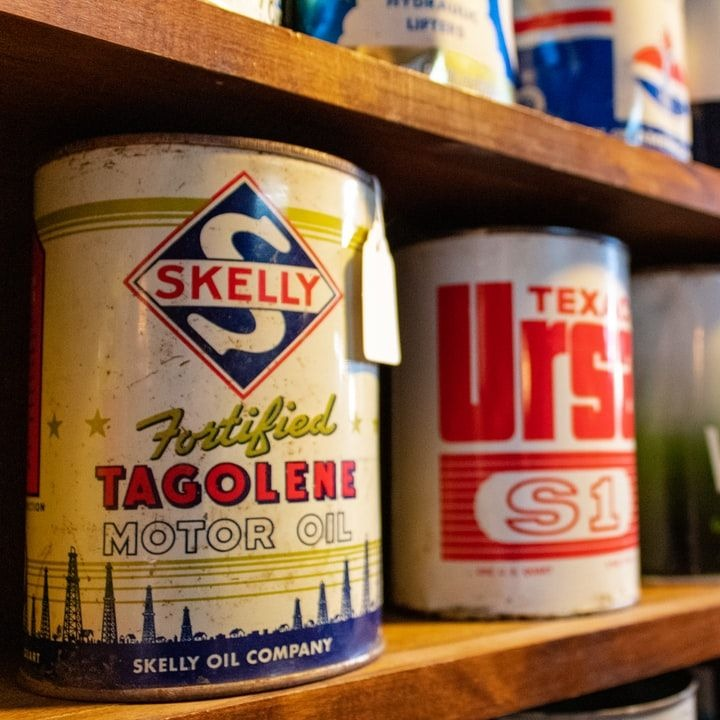 Oil cans on shelfs in hardware store